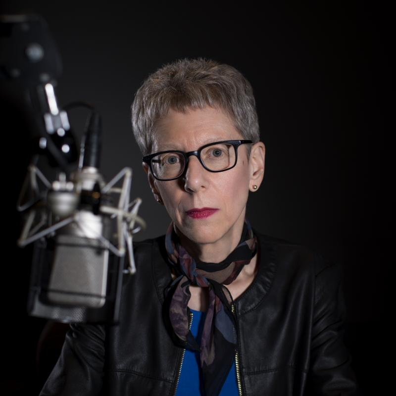 Terry Gross at her microphone in 2018