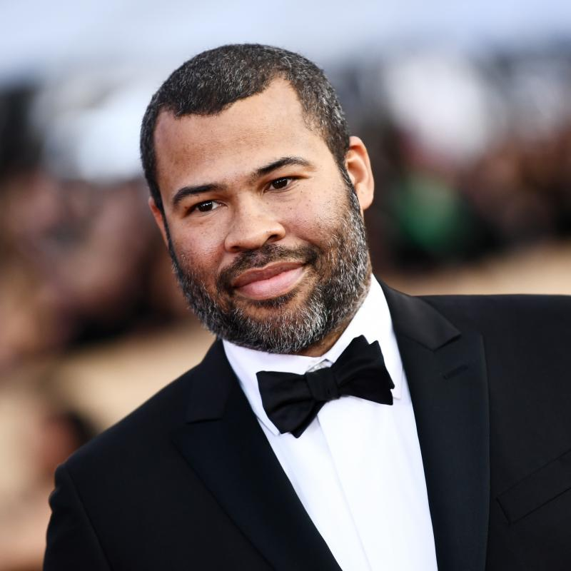 Actor and Director Jordan Peele at an award show in a black tuxedo