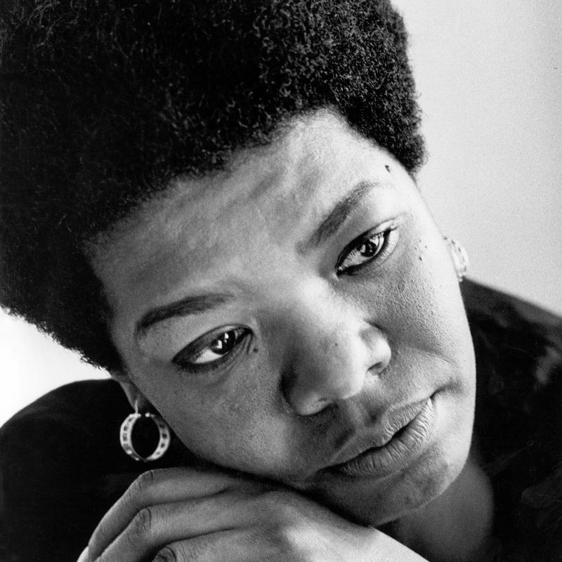 African American author Maya Angelou looks off-camera in a close-up portrait