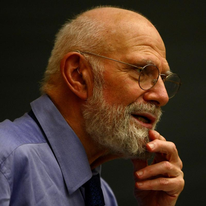 Oliver Sacks stroking his chin during a lecture