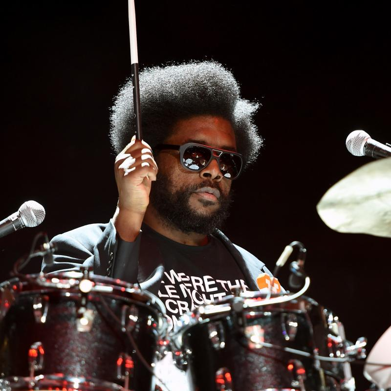 Roots drummer Questlove (Ahmir Thompson) playing drums in sunglasses