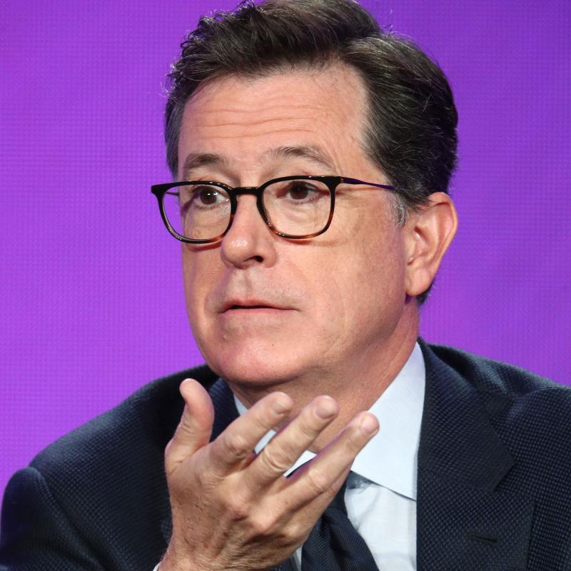 Comedian and Late Night host Stephen Colbert speaking and gesturing