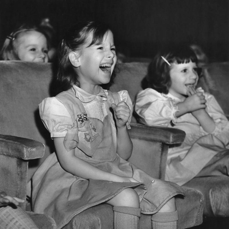 Little girls laughing in an audience