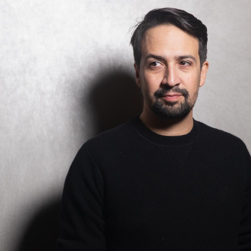 Lin-Manuel Miranda looking away from the camera