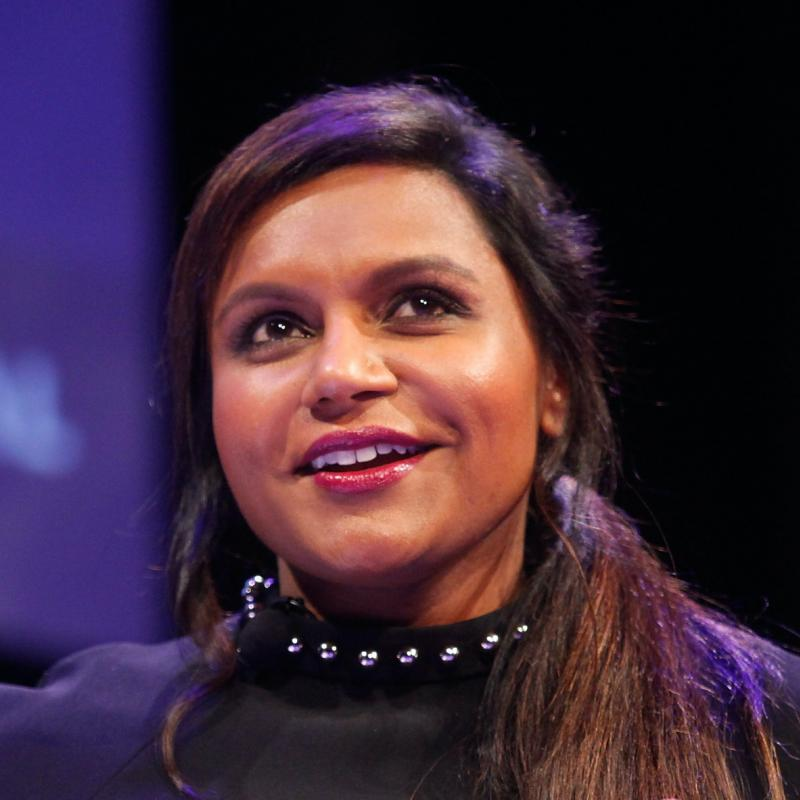 Mindy Kaling smiling giving a speech